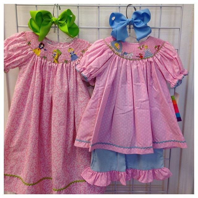 Planning a Disney trip? Check out these cute Disney Princess smocked outfits!#refinerykids #225 #batonrouge #disneyprincess #idratherbeatdisney